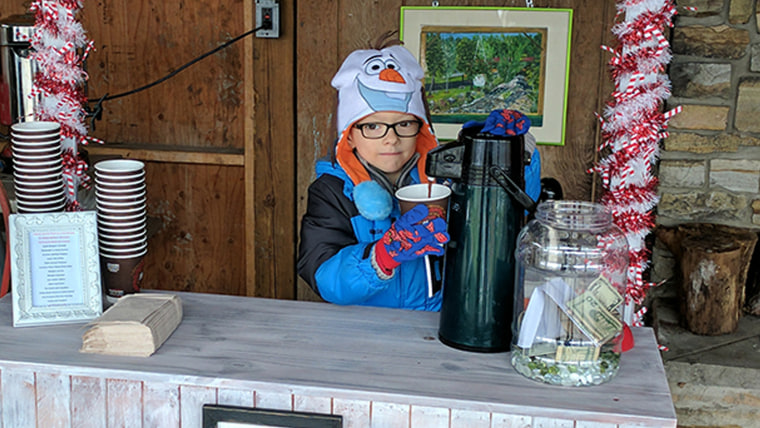Matthew McDonald raises $6,500 from a hot cocoa stand for other kids with cancer.