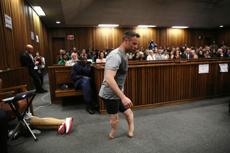 Image: Paralympic gold medalist Oscar Pistorius walks across the courtroom without his prosthetic legs during the third day of the resentencing hearing for the 2013 murder of his girlfriend Reeva Steenkamp, at Pretoria High Court