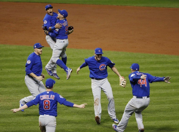 Image: Chicago Cubs players celebrate the final out as the Cubs win the World Series