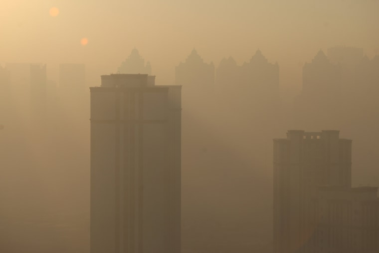 Image: Buildings are seen in heavy smog in Harbin