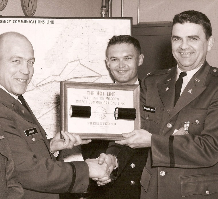 Maj. Glenn Nordin, left, poses for a farewell photo in February 1966, his last month manning the Moscow hotline.