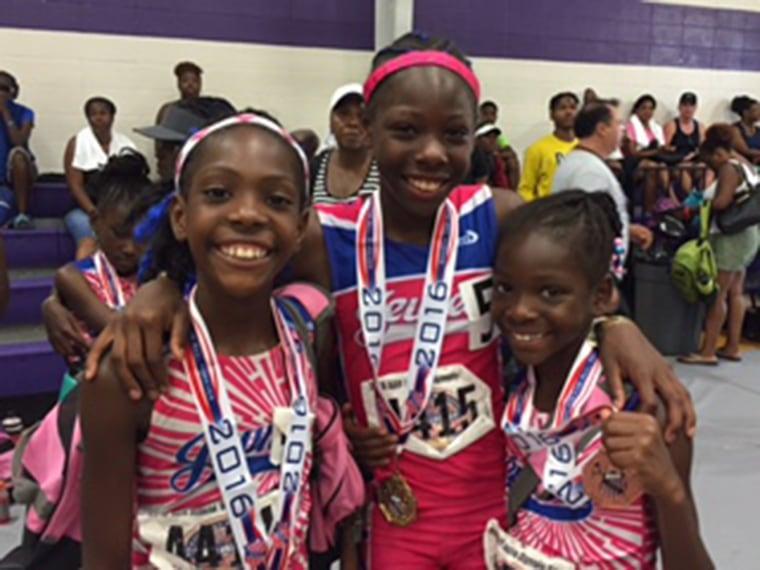 Sheppard Sisters, Rainn, Tai, and Brooke, celebrate their accomplishments after 2016 AAU Junior Olympics in Houston, Texas.