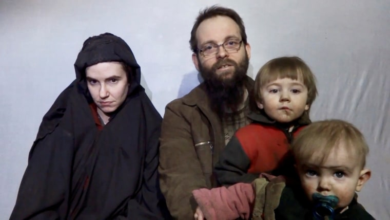 Image: A still image from a  video shows American Caitlan Coleman speaking next to family members