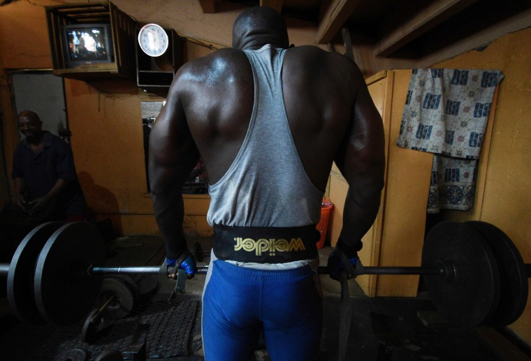 Image: TOPSHOT-UGANDA-WEIGHTLIFTING-BODYBUILDING-FEATURE