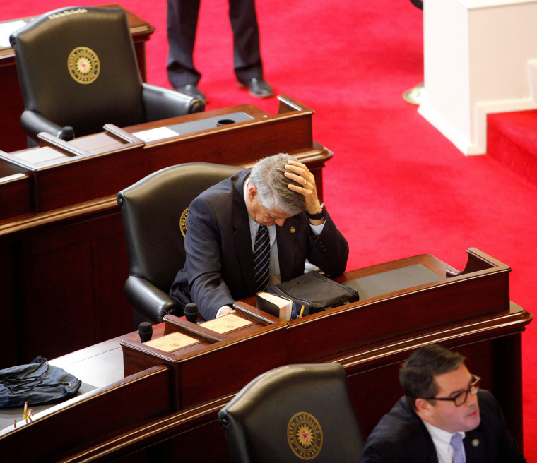 Image: Republican State Senator Norman Sanderson holds his head while fellow Republican Senator Andrew Brock looks during a failed attempt to repeal the controversial HB2 law limiting bathroom access for transgender people in Raleigh, North Carolina