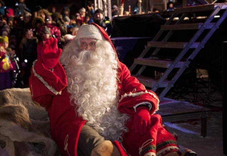 A man dressed as Santa Claus leaves for his annual Christmas journey from the Santa Claus Village at the Arctic Circle in Rovaniemi, Finnish Lapland