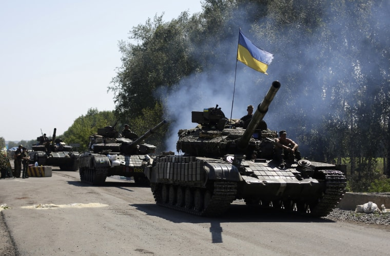 Image: Ukrainian troops patrol near the eastern Ukrainian city of Debaltseve in the Donetsk region on Aug. 3, 2014.