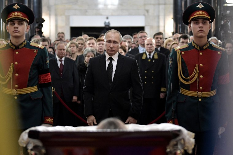 Image: Russian President Vladimir Putin attends a farewell ceremony for the Russian Ambassador to Turkey Andrei Karlov at the Foreign Ministry headquarters in Moscow, Russia, Dec. 22.
