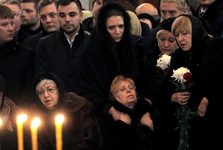 Image: Marina Karlova the widow of killed Russian ambassador to Turkey, Andrey Karlov, and his mother Maria are surrounded by mourners as they attend a memorial service at the Christ the Savior Cathedral, in Moscow, Russia, Dec.22.