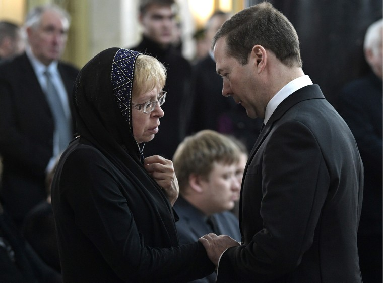 Image: Andrei Karlov's widow Marina and Russia's Prime Minister Dmitry Medvedev seen during a farewell ceremony for Russian Ambassador to Turkey Andrei Karlov at the offices of the Russian Foreign Ministry.
