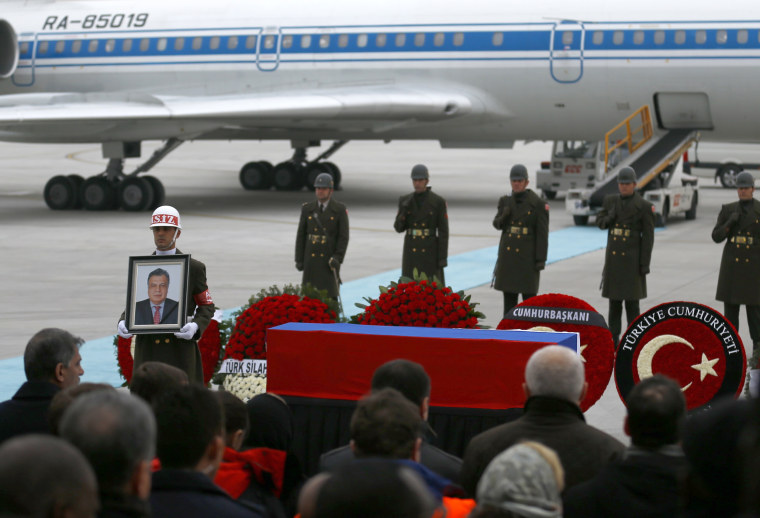 Image: The flag-wrapped coffin of late Russian Ambassador to Turkey Andrei Karlov is carried to a plane during a ceremony at Esenboga airport in Ankara, Turkey, Dec. 20, 2016.