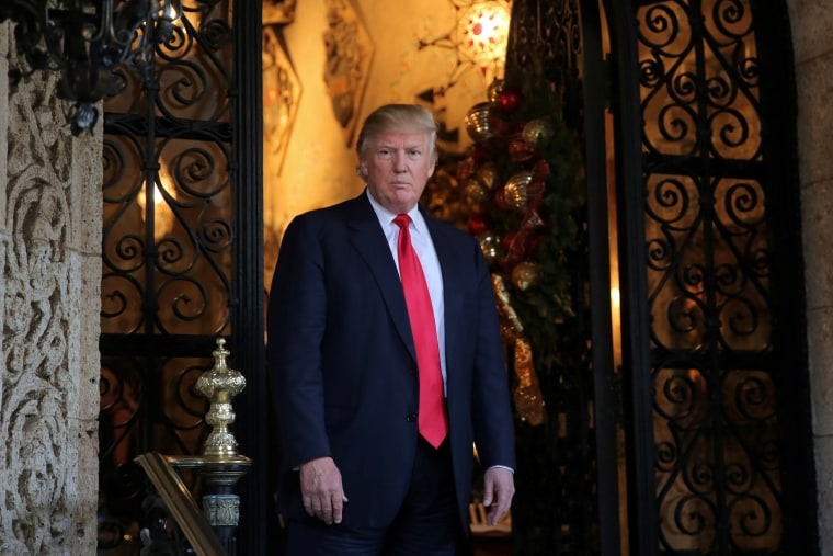Image: President-elect Donald Trump pauses as he talks to members of the media after a meeting with Pentagon officials at Mar-a-Lago estate in Palm Beach, Florida, Dec. 21, 2016.