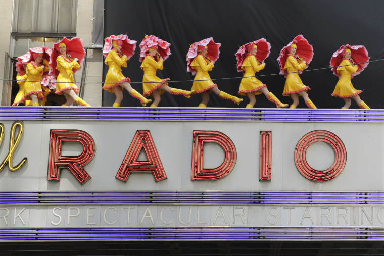 "In this June 7, 2016, file photo, dancers from the Radio City Rockettes promote their ""New York Spectacular"" show by performing on the marquee of Radio City Music Hall in New York. The Radio City Rockettes have been signed on to dance at President-elect Donald Trump?s inauguration next month."