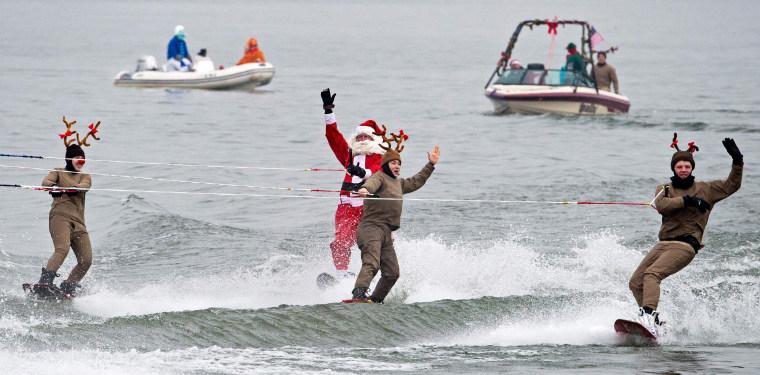 Image: US-CHRISTMAS-WATER-SKIING-SANTA