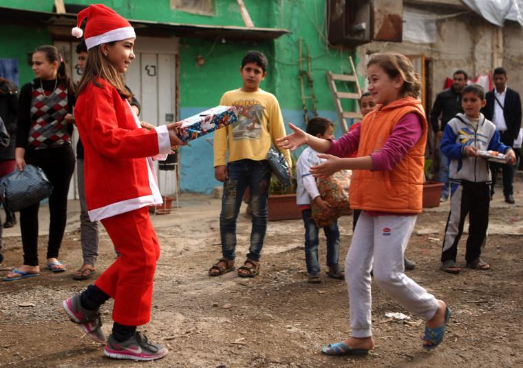 Image: LEBANON-SYRIA-CONFLICT-RELIGION-REFUGEES-CHRISTIANITY