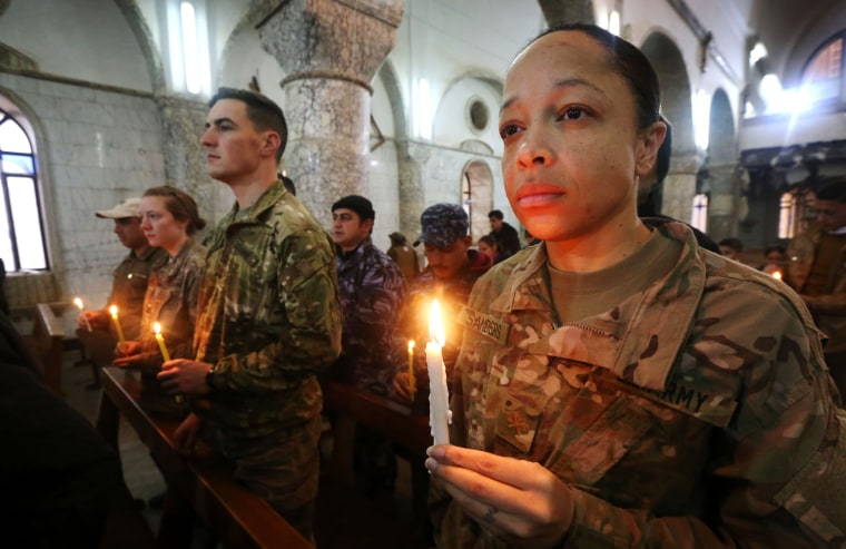 Image: U.S. Soldiers attend a Christmas Eve service for Iraqi Christians at the Saint John's church