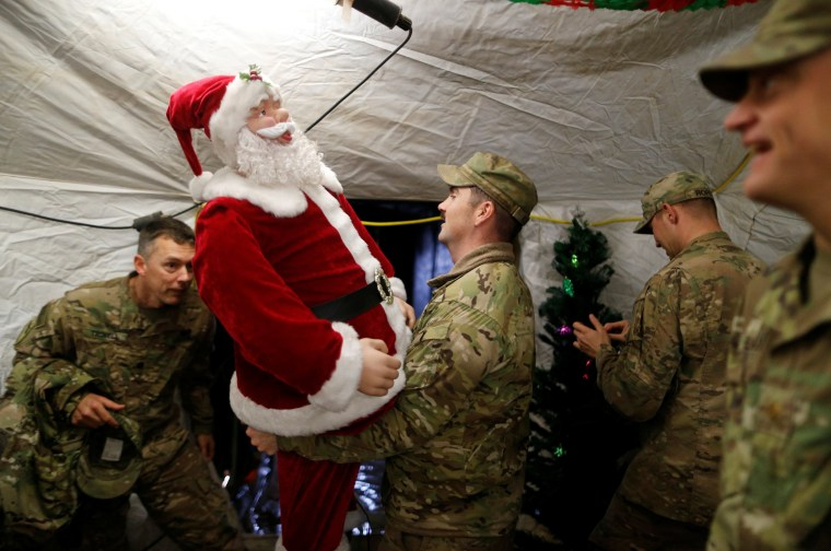 Image: U.S. soldiers enjoy a Christmas dinner at an army base in Karamless town
