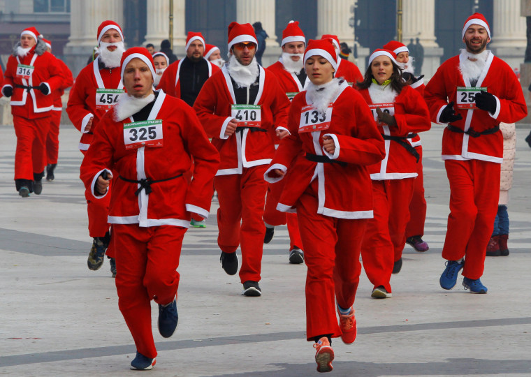 Image: Runners dressed as Santa Claus take part in the annual Christmas race on the streets of Skopje