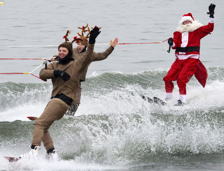 Image: Members of the volunteer Water Skiing Christmas Show perform on the Potomac River