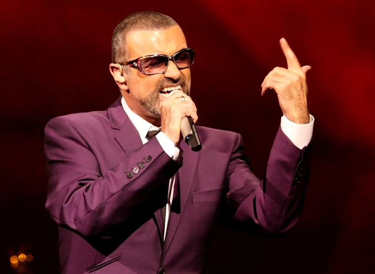 """Image: FILE PHOTO British singer George Michael performs on stage during his \""""Symphonica\"""" tour concert in Vienna"""
