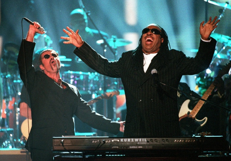 """In this April 10, 1997, file photo, George Michael, left, and Stevie Wonder perform \""""Living for the City\"""" at the \""""4th annual VH1 Honors\"""" in Universal City, Calif."""