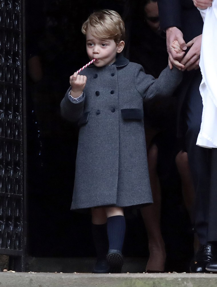 Image: The Duke and Duchess of Cambridge, Prince George, attend a Christmas Day service.