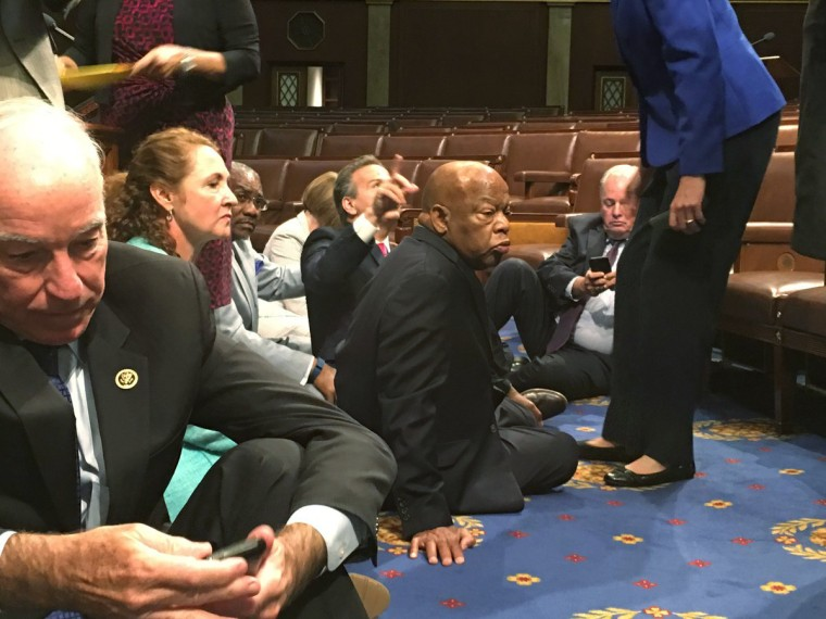 Rep. John Lewis, center, and other Democrats stage a sit-in to demand action on gun legislation.