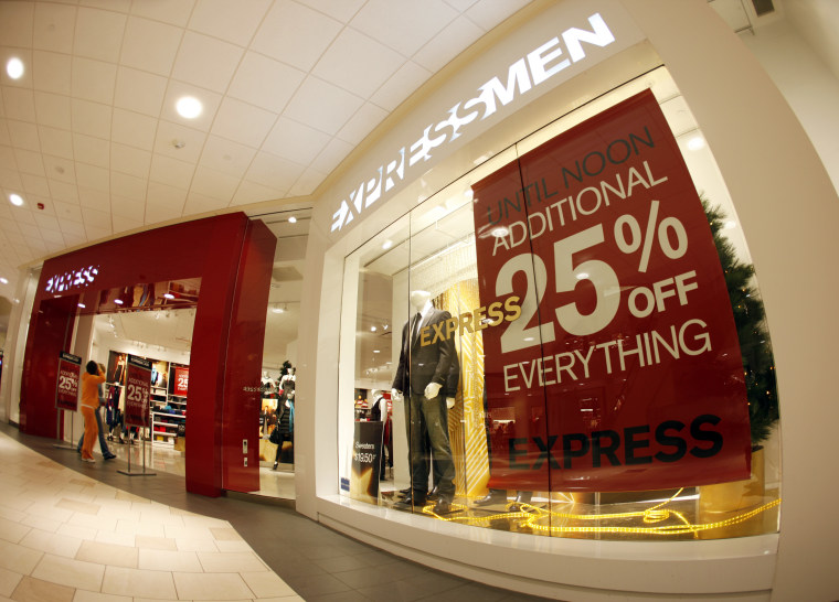 A sign hangs in the display window of a clothing store to call attention to reduced prices for early-morning shoppers at the Aurora Town Center in the east Denver suburb of Aurora, Colo., on Friday, Nov. 28, 2008.