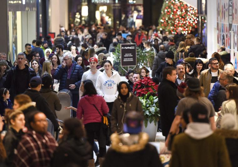 Image: Shoppers walk through the Rideau Centre
