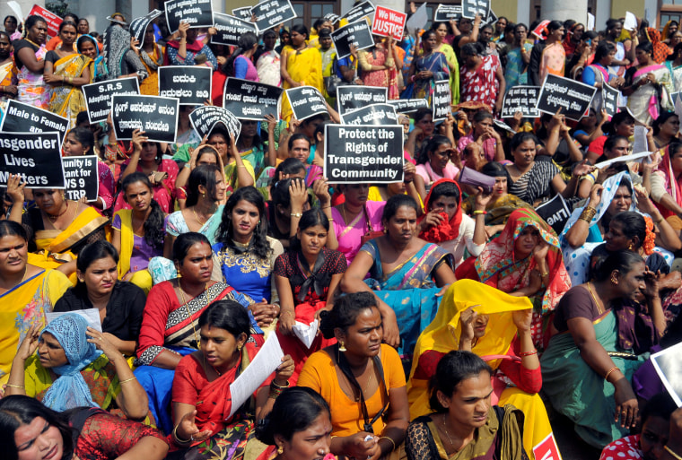 Image: Participants hold placards during a protest demanding an end to what they say is discrimination and violence against the transgender community, in Bengaluru