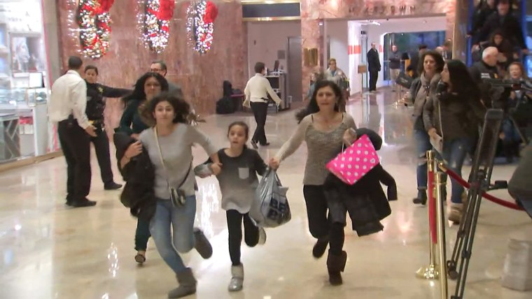 Visitors to Trump Tower run during an evacuation by the New York Police Department, Dec. 27. The suspicious bag that prompted it was later found to contain children's toys.