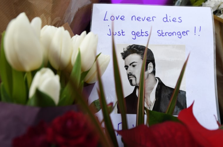 Image: Tributes made to late pop superstar George Michael outside his home in London