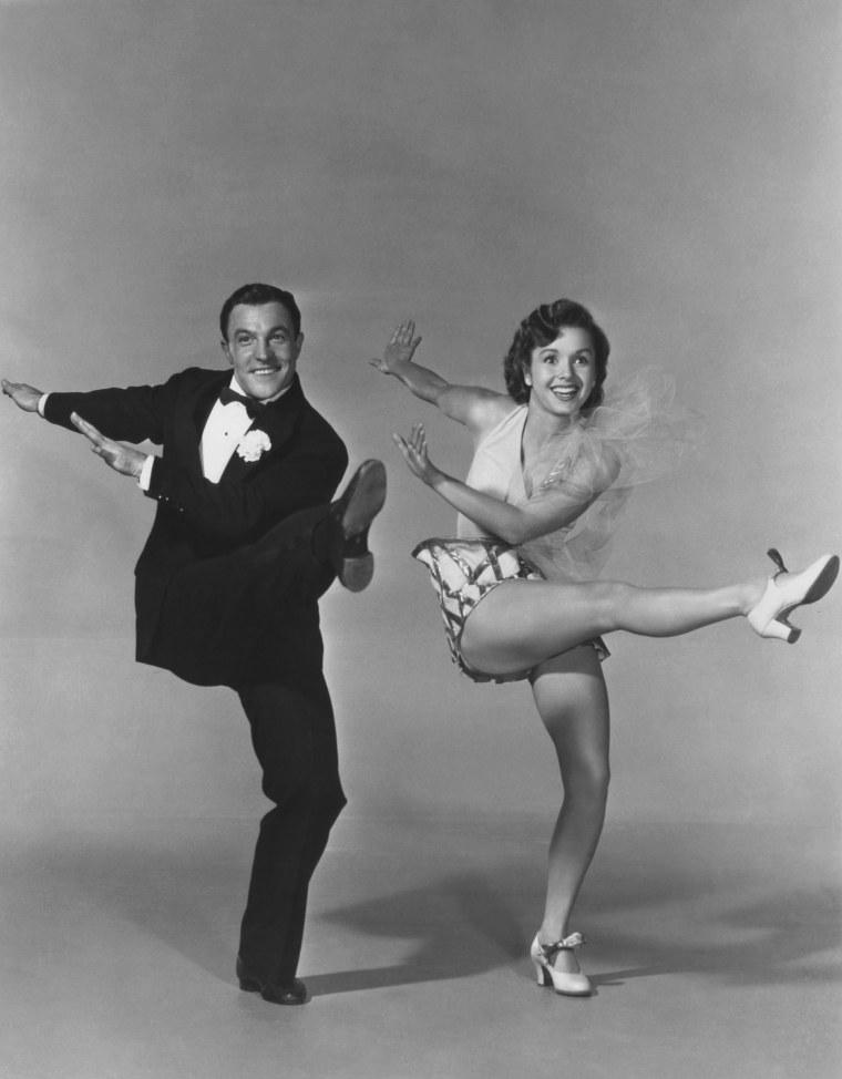 SINGIN' IN THE RAIN, from left: Gene Kelly, Debbie Reynolds, 1952
