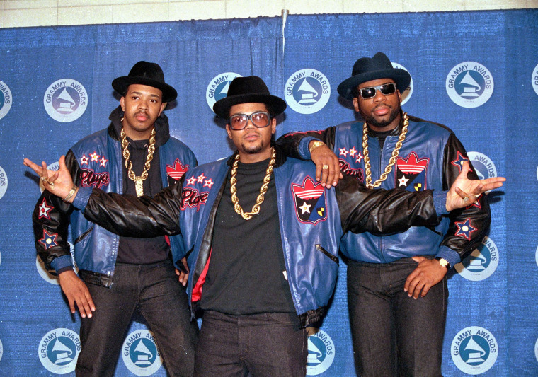 "Image: oseph ""Run"" Simmons, Darryl ""DMC"" McDaniels, and the late Jason Mizell ""Jam Master Jay."""