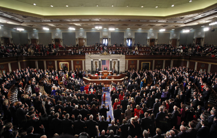 Image: Boehner swears into office the members of the 112th United States Congress on the opening day of their session on Capitol Hill in Washington