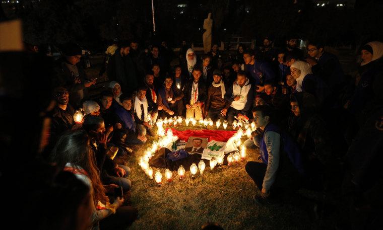 Image: Syrians during a vigil at the Ummayyad Square