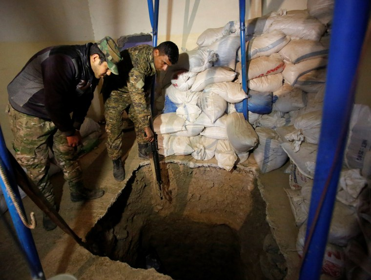 Image: Iraqi soldiers inspect a tunnel used by Islamic State militants during a battle with Islamic State, north of Mosul