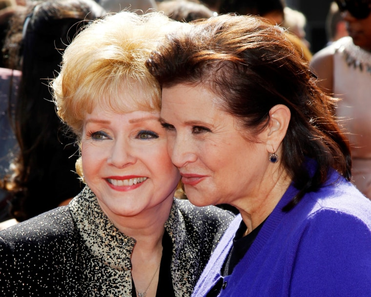 Image: FILE PHOTO: Actress Debbie Reynolds and her daughter Carrie Fisher arrive at the 2011 Primetime Creative Arts Emmy Awards in Los Angeles