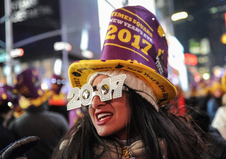 Image: Revelers gather in Times Square on New Year's Eve in New York