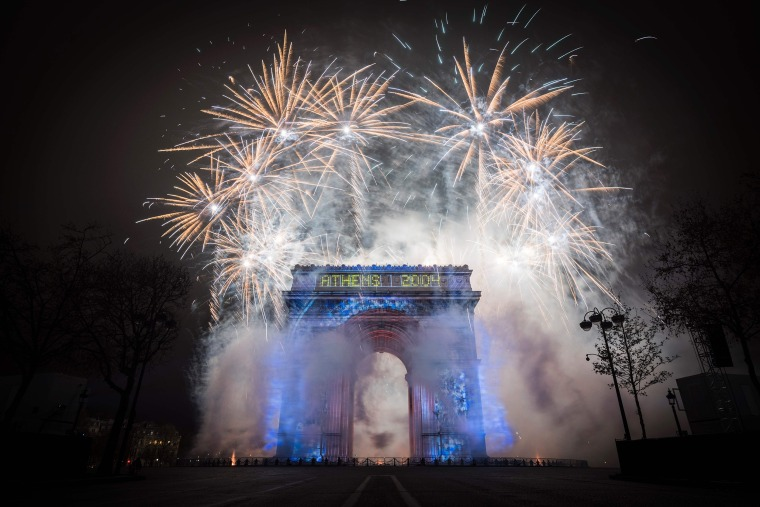 Image: Fireworks explode over the Arc de Triomphe