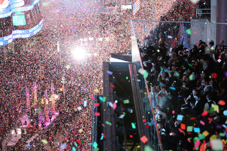 Image: Revelers celebrate as confetti flies