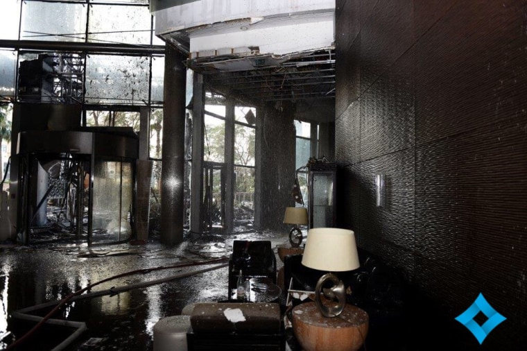 Water drips from the ceiling of a charred room at the Address Downtown Dubai hotel on Jan. 1, 2016.