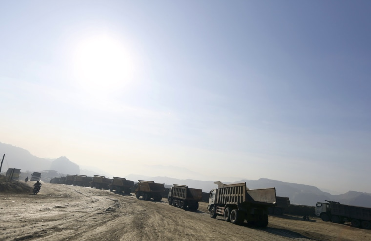 Image: Trucks are seen at a jade stone mine dump at a Hpakant jade mine in Kachin state in Myanmar