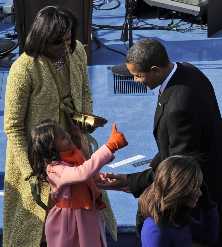 Image of Sasha Obama giving her father, President Obama, a thumbs up after his 2009 inauguration speech.
