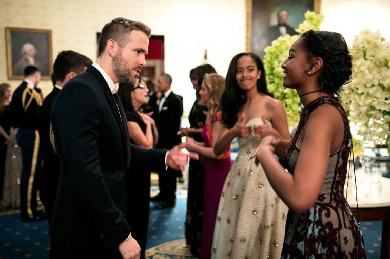 Image: Sasha and Malia talk with actor Ryan Reynolds
