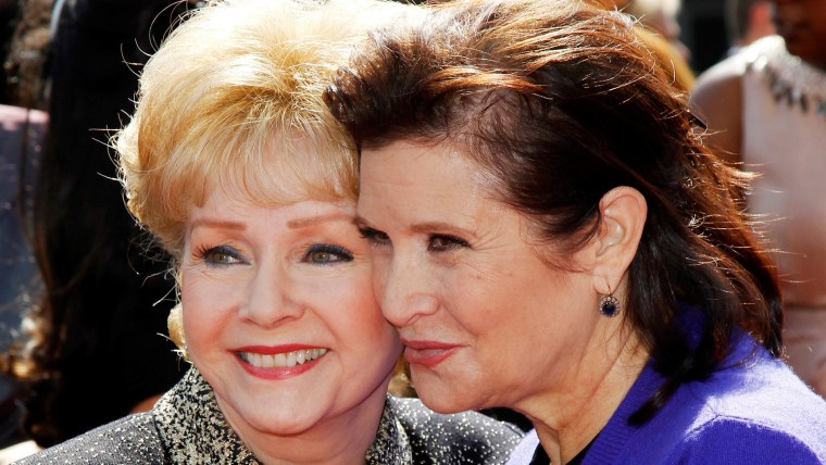 Debbie Reynolds and her daughter Carrie Fisher arrive at the 2011 Primetime Creative Arts Emmy Awards in Los Angeles
