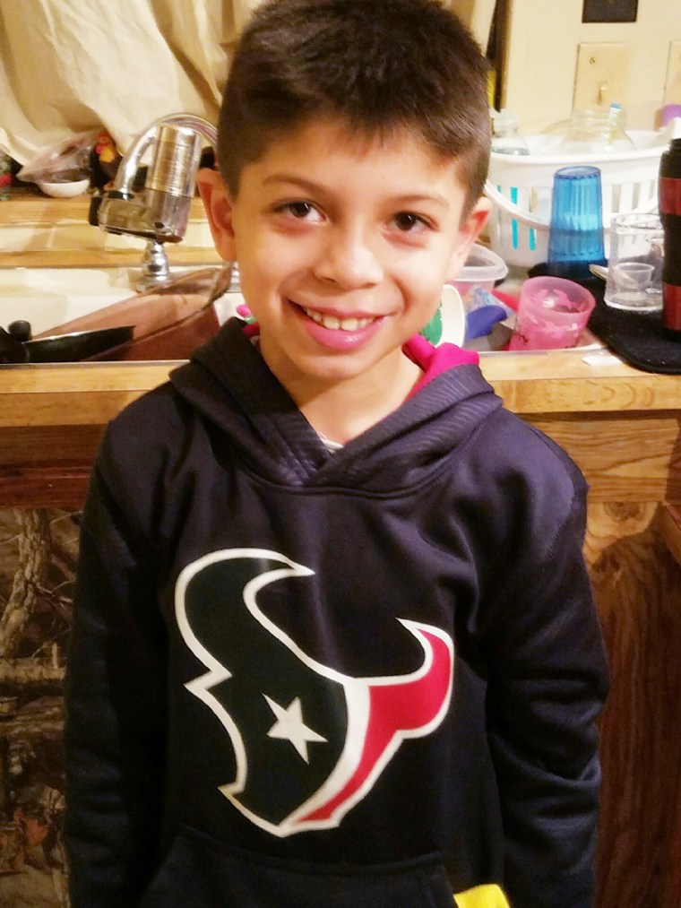 Houston Texans football player J.J. Watt surprising young fan, Noah Fulmer, 8, after he was in a car accident.
