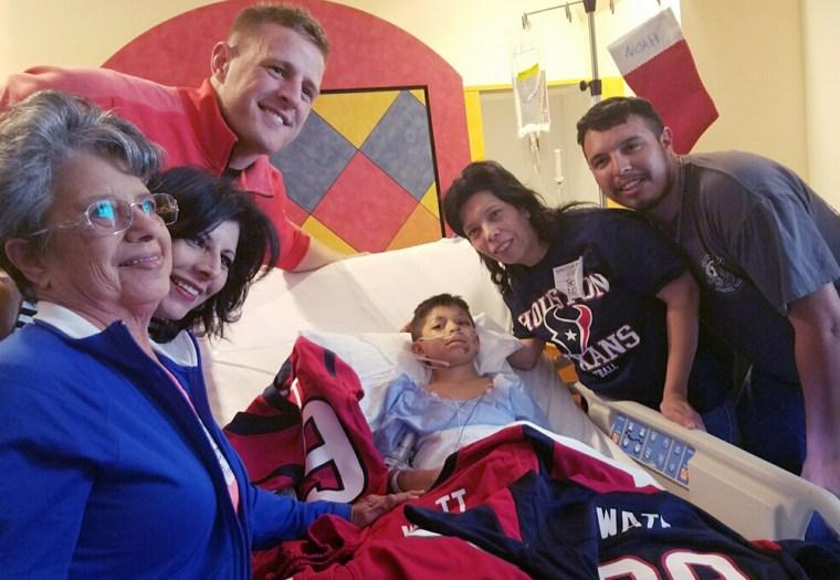 Texans' J.J. Watt surprises a boy hit by a car with new jerseys.