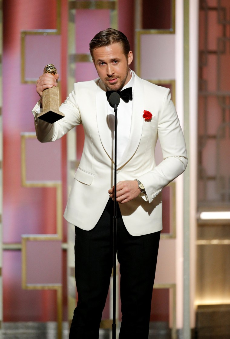 "Image: Actor Ryan Gosling holds his award for Best Actor, Motion Picture - Musical or Comedy for ""La La Land"" during the 74th Annual Golden Globe Awards show in Beverly Hills"