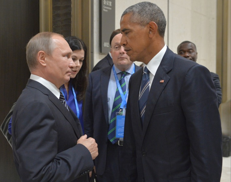 IMAGE: Vladimir Putin and Barack Obama